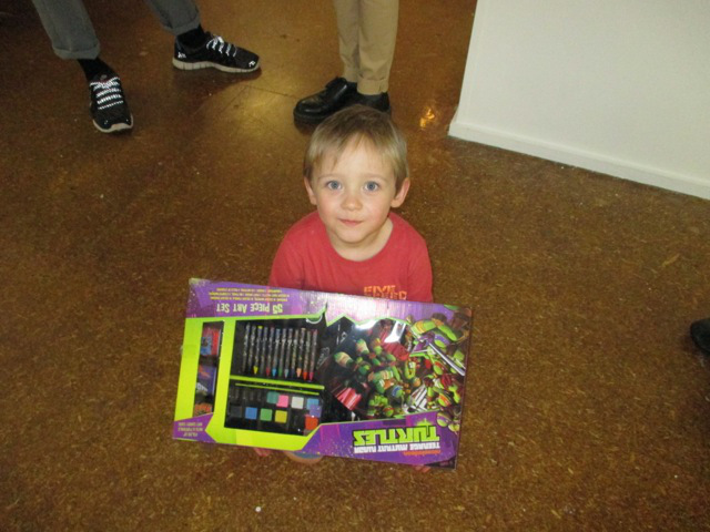 Louis Watts, the youngest ever contestant receives prize for the youngest ever contestant 55 Ninja Turtles portable painting set
