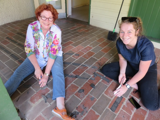 Carol and Sabrina find time for a chat while scrapping something really annoying off the verandah