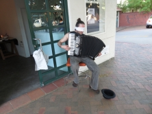 Blindfolded accordion player